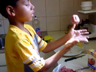 Chef Luchiano prepares hamburgers